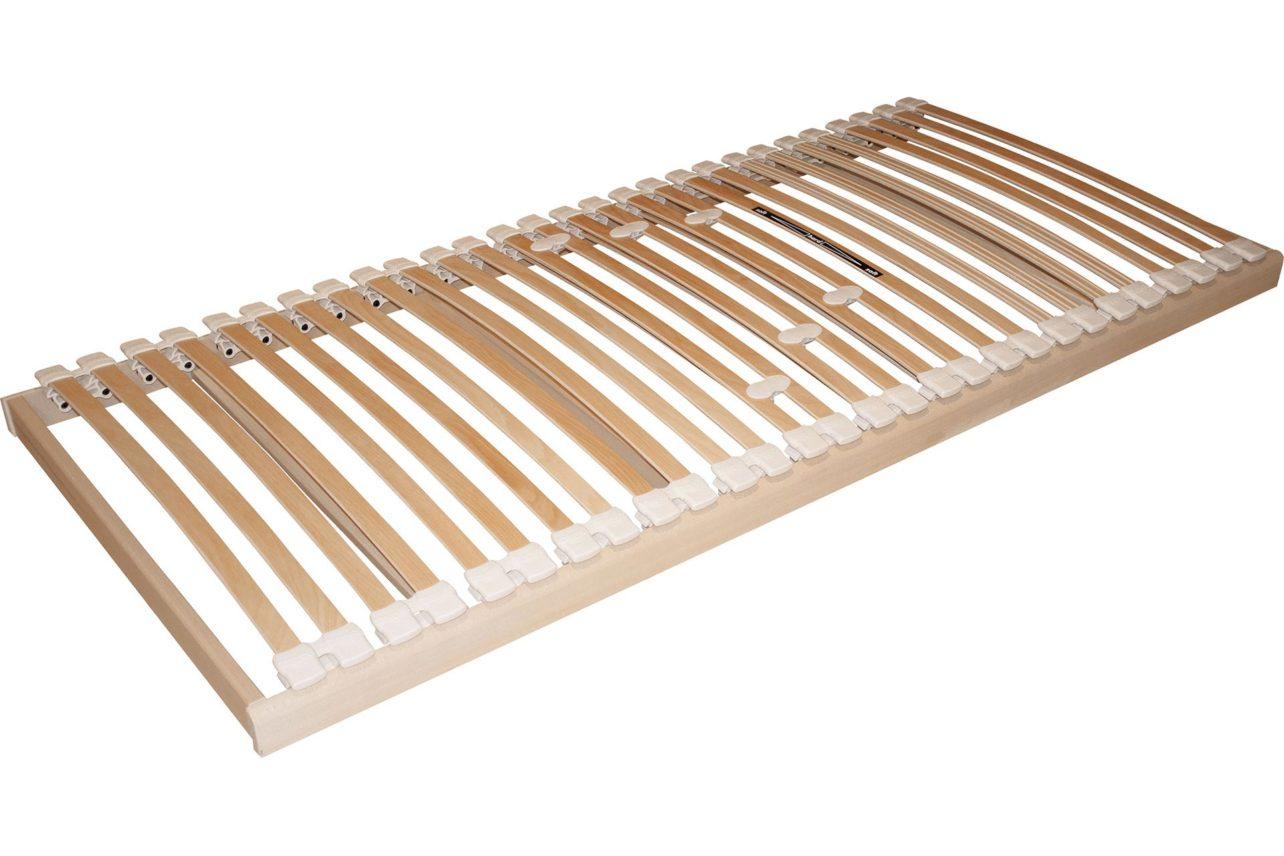 Lattenrost Flexo mit 28 Federleisten aus schichtverleimter Buche, gelagert in elastischen Kautschukkappen. Ohne Sitz- oder Fußhochstellung. Niedrige Einbauhöhe: 9 cm.